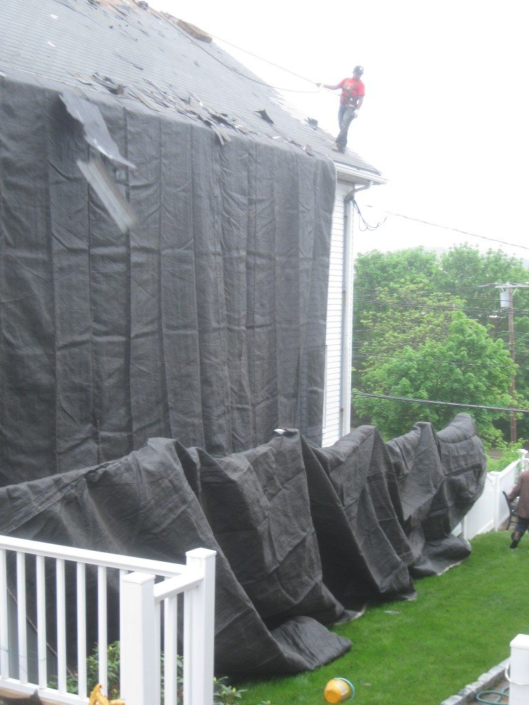Using tarp to prevent damage to residence and landscape
